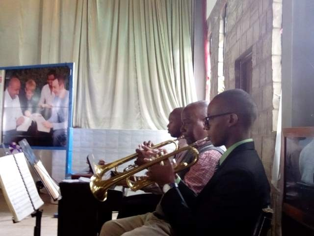 Daniel and Baba Stanley playing at the wedding. Luke Chege is on the piano.